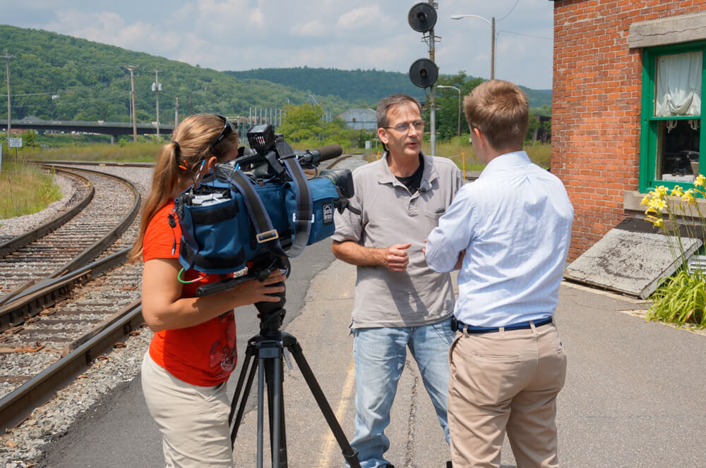 A man being interviewed by the press