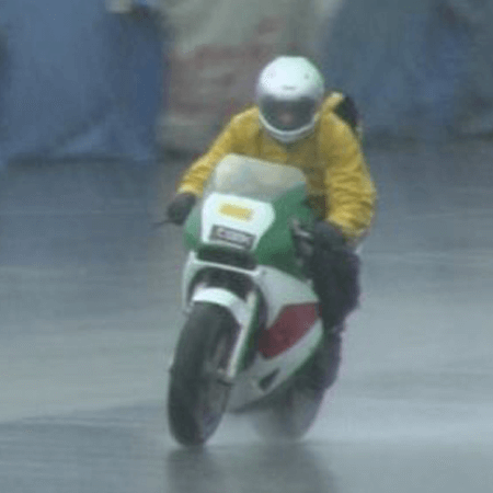 Portrait of Bob LoCicero riding his motorcycle in the rain
