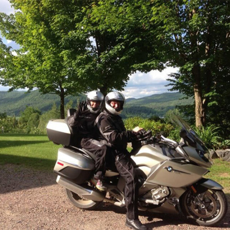 Portrait of Gary Margolis and his wife on their BMW motorcycle