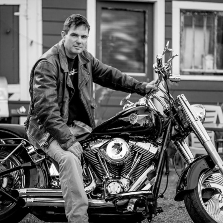 Black and white portrait of James Lockridge on his Harley Davidson