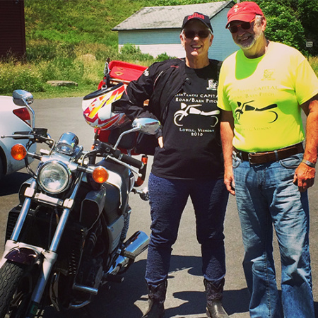 Portrait of Steve Mason and Trish Sears standing next to their vintage Yamaha motorcycle