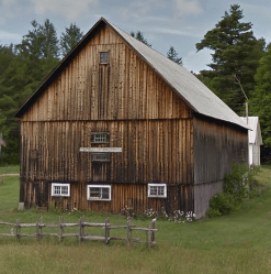 An exterior picture of a beautiful wooden barn