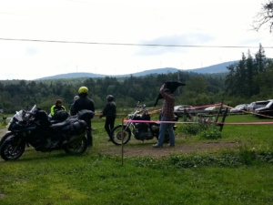 Motorcyclists enjoy the view of a Vermont landscape with mountains in the background