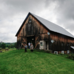 A beautiful wooden barn on a bright green lawn