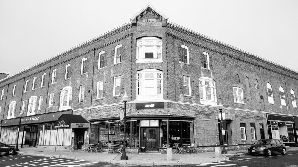 Black and white picture of a historic brick building